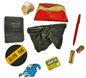 Eric Nordstrom of Urban Remains found a Depression-era purse full of personal items inside the theater's air circulation chamber.