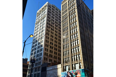 The city is trying to sell these two vintage towers near State and Adams streets. The federal government bought the towers years ago but never used them.
