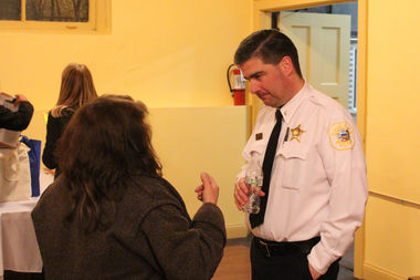 Near North Police Cmdr. Paul Bauer talks with a local resident after Tuesday's public-safety forum.