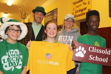 Clissold Elementary School expects a big showing at the Ridge Run again this year. The school had 100 participants in the neighborhood race last year. Pictured here from left: Antonio Fox, Principal Sean McNichols, Sydney Smith, BAPA Executive Director Margot Burke Holland and Victor Davis.