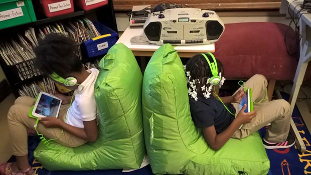The calm spots include two green beanbag chairs, green tablets that display two-minute videos of nature scenes — such as a waterfall, or a cow eating from a pasture — and green headphones.