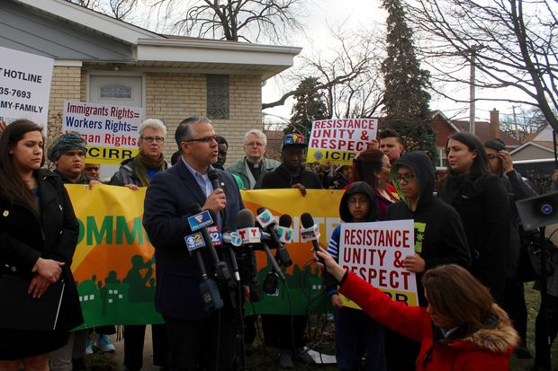Ald. Gilbert Villegas (36th) speaks at a Tuesday rally condemning the ICE raid that left a 53-year-old man wounded.