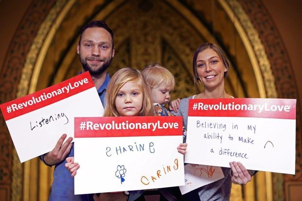 Caitlin Reller (right), with her husband Caleb Engstrom and daughters are Ella and Iona, posing for Middle Collegiate Church's #RevolutionaryLove project.