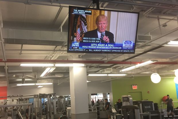 A TV screen showing the news at a Woodside Blink Fitness. During April, the gym will shut the news off every Monday to decrease gym-goers stress.