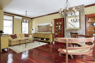 This townhouse at 16 Sylvan Terrace in Washington Heights is listed by Stribling at $1.625 million.