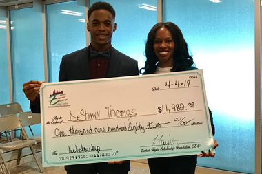 DeShawn Thomas, a senior at South Shore High School, received a nearly-$2,000 scholarship from Tenisha Taylor Bell's Ezekiel Taylor Scholarship Foudnation.