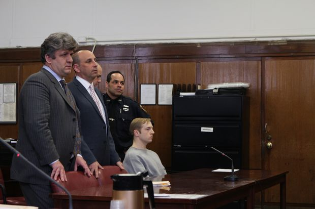 James Harris Jackson, 28, with his attorney Patrick Brackley, far left, and his previous attorney Sanford Talkin in Manhattan Supreme Court on April 5.