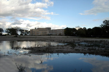 The city is delaying for a month a decision to pick a developer for the former Michael Reese Hospital site.