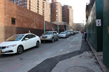 Cars waiting to enter the Williamsburg Bridge line up down Clinton Street.