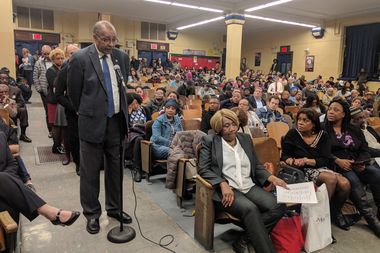 Crown Heights residents speak at a public meeting regarding a proposed homeless shelter at 267 Rogers Ave., including James Caldwell, left, the president of the 77th Precinct Community Council, who spoke in support of the project.