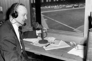 Jack Brickhouse in the Comiskey Park press box as he prepares to announce a White Sox game in 1948