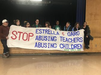A group parents at CPE 1 protesting in the auditorium.