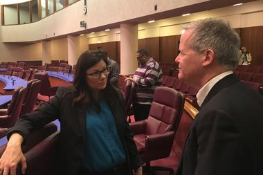 Laura Kunard, Inspector General Joseph Ferguson's pick to lead a new office designed to scrutinize police misconduct, speaks with 46th Ward Ald. James Cappleman after her confirmation hearing.