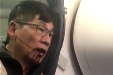 A still from a Twitter video shared by a user who was allegedly on the  United Airlies flight where a passenger was forced off by aviation police.