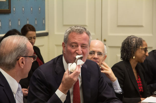 The mayor chowed down on a cannolo from Royal Crown Bakery as part of his welcome to Staten Island.