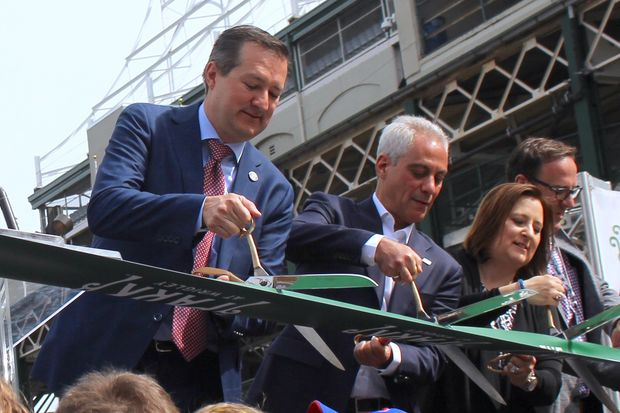 From left: Tom Ricketts, Mayor Rahm Emanuel and Laura Ricketts cut the ribbon during the Park at Wrigley opening ceremony Monday.