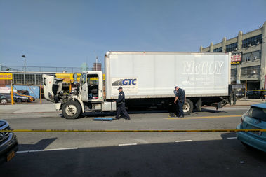 The cyclist was hit by the large truck as it tried to make a turn, police said.