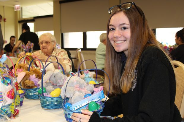 Sixty Easter baskets for homeless children were put together Tuesday afternoon by residents of Mercy Circle and students at Mother McAuley Liberal Arts High School