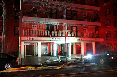 The fire broke out at around 6:25 p.m. in the the area between the roof and top floor of The Martinique at 52-11 94th St., a block from the busy Queens Center Mall, on Tuesday.