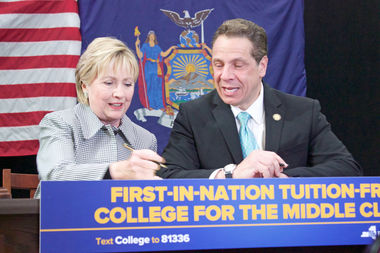 Hillary Clinton joined Gov. Andrew Cuomo in Queens to sign the state's new free college tuition bill into law on April 12, 2017.