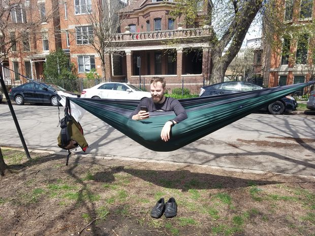 Jacob Matz enjoying a sunny day in his hammock with his dog, Scout.