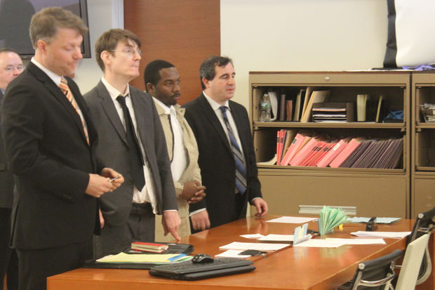 Steven Odiase (third from left) in court.
