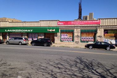 A long-blighted building on Empire Boulevard lost a potential contract with Dollar Tree because actual trees growing inside the building were undermining its structure.
