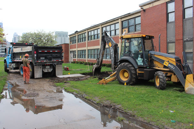 A city crew replaces a water main outside a community center at 1000 N. Sedgwick St.