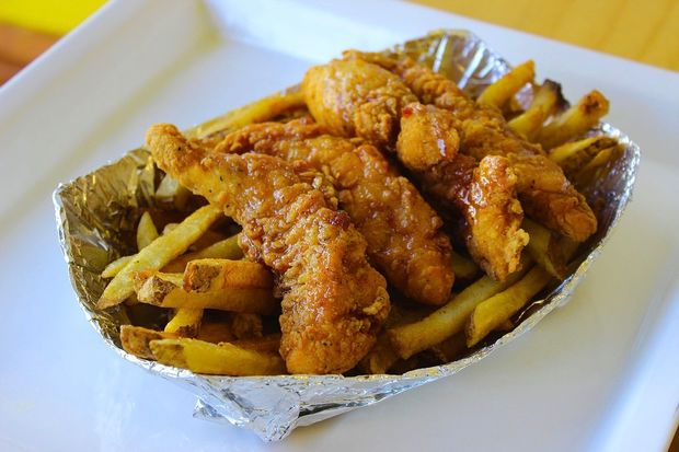 A basket of Crazy Bird chicken over fries