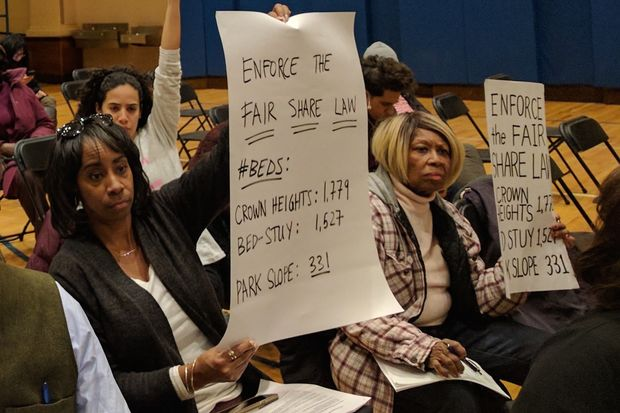 Neighbors of a shelter slated to open at 1173 Bergen St. in Crown Heights protest at a public hearing about the facility on March 15, 2017. Critics of the shelter say the neighborhood is oversaturated, particularly when compared to other Brooklyn neighborhoods like Park Slope.