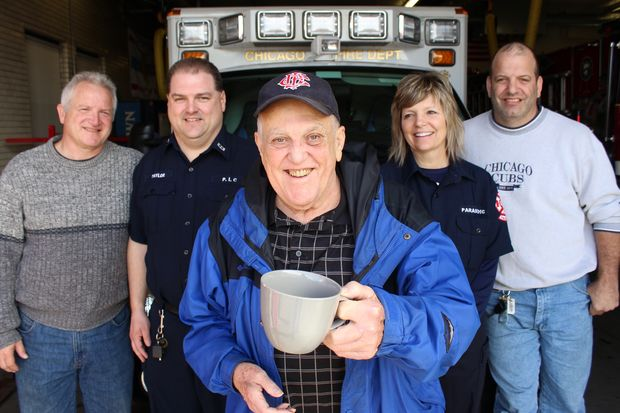 Retired Chicago Fire Department Lt. Robert Zolna (center) of Beverly was revived after going into cardiac arrest Feb. 9 by the many of the same firefighters and ambulance personnel he meets for every day for coffee at the firehouse in Mount Greenwood.