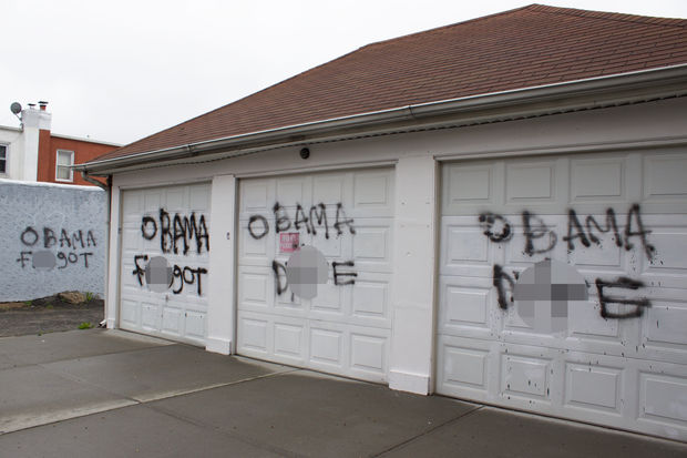 """Obama f----t"" and ""Obama d--e"" was written five times on the front and sides of the garages, located on 23rd Street between 28th and 29th avenues in what appeared to be black spray paint."