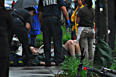 A man is treated after a bicycle accident.