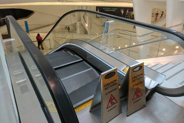 The escalator buckled as the men were on it inside the Greenwich Street transit hub, officials said.