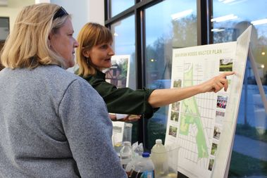 Chris Slattery (right) is the planning and development coordinator for the Forest Preserves of Cook County. She explained several new developments in the Dan Ryan Woods to nearby residents Wednesday evening.