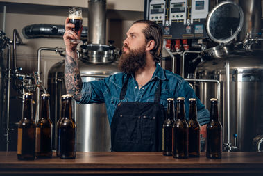 A bartender examines craft beer in this file photo.