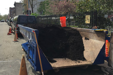 A big pile of compost sits outside the Hattie Carthan Community Garden on Thursday waiting to be picked up by neighborhood gardeners.
