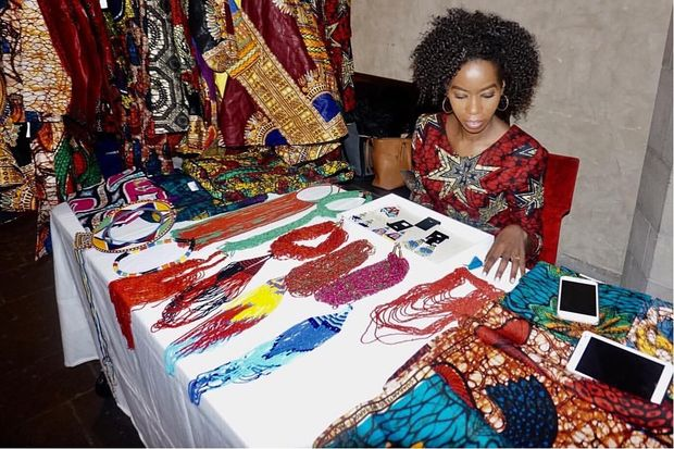 A table of products from ILAVA: It Can Be Done's fashion line, made by artists in Kenya and Tanzania.