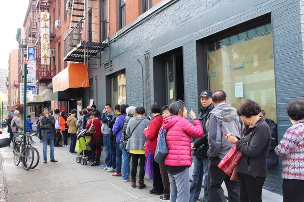 Hopeful applicants seeking affordable housing at Essex Crossing line up for language assistance outside the Chinatown offices of Asian Americans for Equality.
