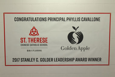 A banner at St. Therese's congratulates Principal Phyllis Cavallone-Jurek on her award.