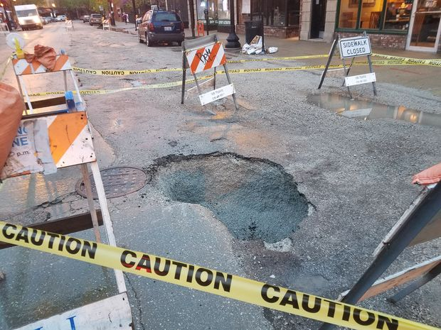 This sinkhole on Broadway sank a Jeep, injuring its passenger.