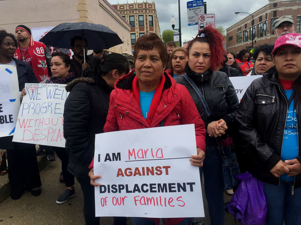 Dozens of residents and community leaders marched down Kedzie Avenue to Pierre's Bakery, 2747 N. Milwaukee Ave., Monday morning to make their voices heard.