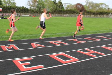 Track athletes compete in a relay at Marist High School during a conference invite on Tuesday. Coaches and athletes hope the improved track facilities will lead to post-season success.