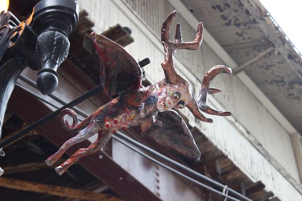 The city is testing out new art on light poles in the Loop, starting with two creepy sculptures at Randolph and Wabash.