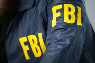 An FBI SUV that was stolen early Monday — with guns and a bulletproof vest inside — was found Monday night.