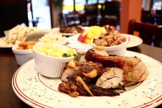 A new Jamaican restaurant specializing in jerk chicken has opened in Wrigleyville.