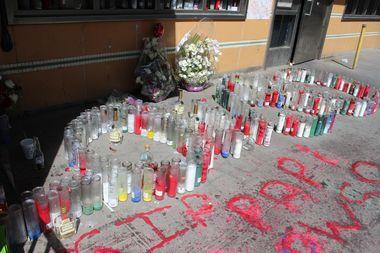 A shrine built in candles outside Elder's Bushwick Houses home read