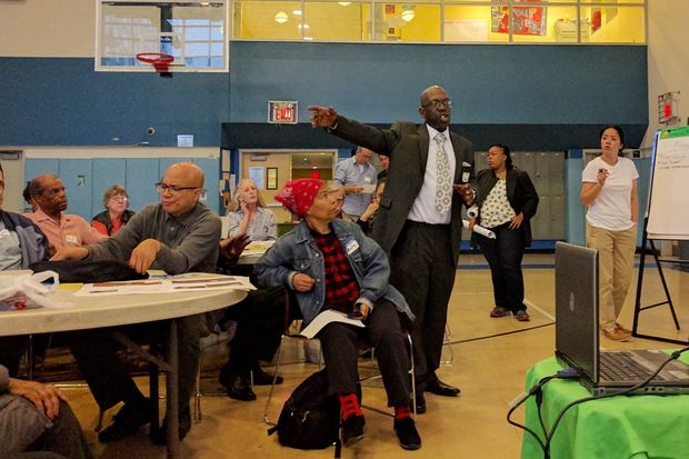 Darold Burgess, a tenant association leader at the Ingersoll Houses, speaks at the Parks Department meeting on Wednesday night regarding the Fort Greene Park renovation plan.