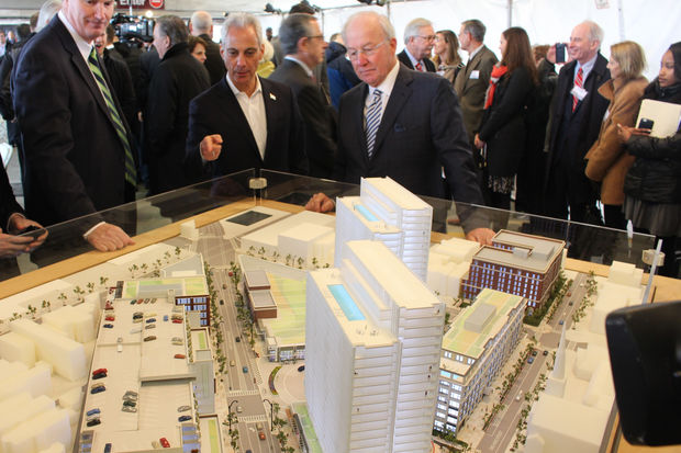 Mayor Rahm Emanuel and developer Dan McCaffrey examine a scale model of the Lincoln Common at Thursday's groundbreaking. They're basically looking southeast down Lincoln Avenue from its intersection with Fullerton and Halsted.