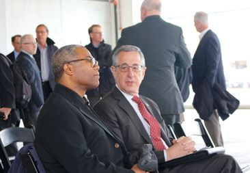Ald. Walter Burnett and Planning and Development Commissioner David Reifman chat before the opening of Clybourn 1200.
